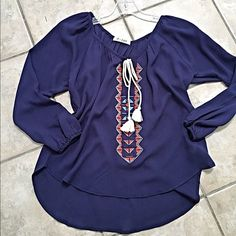 Last one! Stunning navy boho tie front blouse! Pretty contrast in color! Ivory tie front- rounded hemline- must have! Tops Blouses