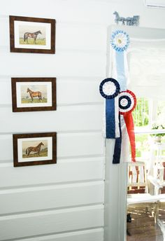 Love the horizontal board and batten and framed photos.