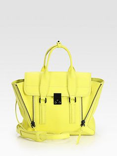 """3.1 Phillip Lim Pashli Medium Satchel    A roomy carryall in luxurious shark embossed leather with expandable side zippers.  Double top handles, 4"""" drop  Detachable adjustable shoulder strap, 20¼""""-24"""" drop  Push-lock flap closure  Expandable side zippers  One inside zip pocket  Fully lined  12""""W X 9½""""H X 4""""D  Imported  Please note: Hardware varies by bag"""