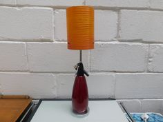 """BOC SPARKLETS - VINTAGE SODA SIPHON TABLE LAMP £38.00  Fab 1970's red soda siphon upcycled into a table lamp  Complete with chrome base   New cable, plug and chrome bulb holder  18 1/2"""" High  Beautiful functional, decorative item for the vintage retro lover   All our items are pre-owned and vintage, so may have light signs of use & wear typical of age. A Table, Table Lamp, Decorative Items, Soda, Retro Vintage, Lamps, Chrome, Bulb, Signs"""