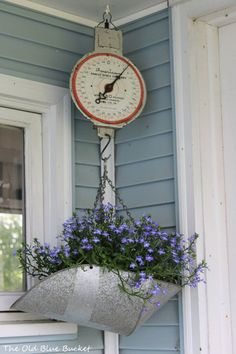 Welcome To My Potting Shed -could do same type of arrangement with buggy hood(?) Welcome To My Potting Shed -could do same type of arrangement with buggy hood(? Shed With Porch, Old Scales, Garden Cottage, Shed Plans, Garden Planters, Porch Planter, Hanging Planters, Outdoor Projects, Porch Decorating