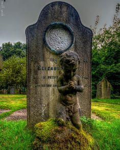 A grave at Ormskirk church of St. Peter & St. Paul. Gothic gravestone angel pray graveyard