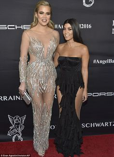 Grinning and bearing it: Kourtney and Khloe Kardashian stoically smiled at the Angel Ball ...