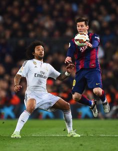 Lionel Messi of Barcelona controls the ball from Marcelo of Real Madrid CF during the La Liga match between FC Barcelona and Real Madrid CF at Camp Nou on March 22, 2015 in Barcelona, Catalonia.