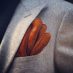 In winter, a pair of suede gloves can be the perfect pocket square.