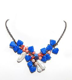 Orange Blue Beaded Necklace, Flower Necklace, Bib Necklace, Nature Jewelry with coral carnelian pearls leaves. $61.95, via Etsy.