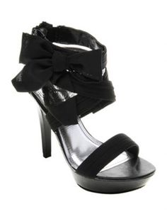 Now every woman can have a best friend named Jenni! These sexy blackhigh heels are 12cm in height and are complete with a flirty chiffon bow on theankle. Black straps encase your foot and ankle perfectly and offer essentialsupport.