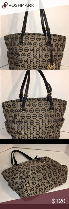 Gorgeous! Michael Kors Signature Jacquard Tote Beautiful Michael Kors Signature Jacquard large tote in excellent condition showing only very minimal signs of use! Excellent interior. From a smoke/pet free home. Michael Kors Bags Totes