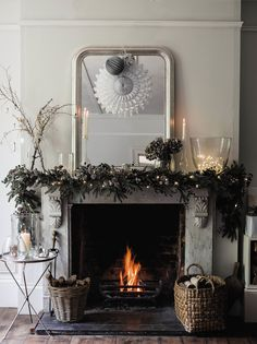 Have a look at the comfort level photos of Christmas Decoration Ideas Bringing The Christmas Spirit from a real expert - British company The White Company. Fireplace Mantel Christmas Decorations, Christmas Mantels, Noel Christmas, Xmas Decorations, Rustic Christmas, White Christmas, Christmas Greenery, Hygge Christmas, Fireplace Ideas