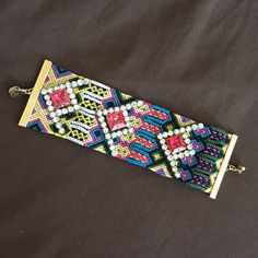 "Anthropologie Tribal Bracelet A great piece to have for summer, adds a lot of colour to your outfit.  6.5"" to 7"" long 2"" wide, magnetic closure.  In brand new condition, no missing stone or lose thread. Anthropologie Jewelry Bracelets"