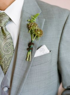 Find flower or green in bouquet that is long and thin.