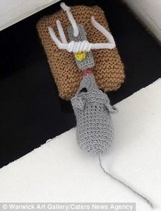 A grey woollen mouse with a trap can be found in the knitchen