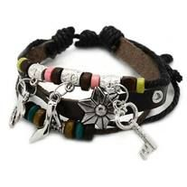 Multi-strand leather type bracelet with silver charms. $5.00 at www.billiesbling.storenvy.com.