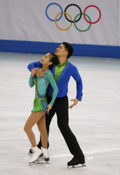 China's Cheng Peng and Hao Zhang compete during the Figure Skating Pairs Short Program at the Sochi 2014 Winter Olympics
