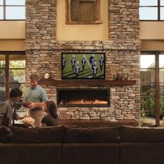 Lower 2/3 - Similar for Sunroom fireplace. *** Interior. Boral Cultured Stone Decor Ideas Come With Rectangle Fire Place And Wooden Beams Mantels Plus Nice Lcd Tv Along With Brown Fabric Couch Also Wooden Glass Windows Paneling Plus High Ceiling Design. Create A Rustic Decor In Your Home With Boral Cultured Stone Ideas