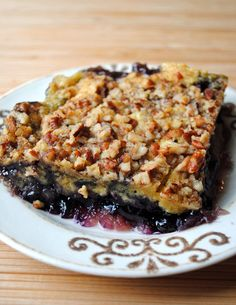Blueberry Pecan Crisp - layers of pineapple, blueberry pie filling, yellow cake mix and pecans. An easy to make crowd-pleaser!