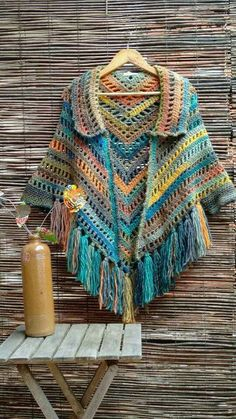 Poncho with collar, fringe , and ties Poncho Au Crochet, Crochet Cape, Crochet Poncho Patterns, Crochet Shawls And Wraps, Crochet Jacket, Crochet Scarves, Crochet Clothes, Crochet Stitches, Knit Crochet