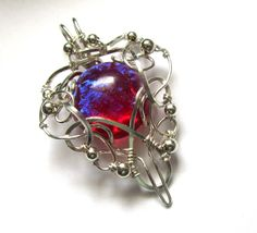 Dragon's Breath Fire Opal Pendant - Silver Wire Wrapped Necklace - Medieval, Elven, Elvish Jewelry - Heart of Fire. $65.00, via Etsy.