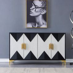 Bring contemporary aesthetic to your space with this essential sideboard buffet. A classic color blend of black and white and the design of geometric figure joint patterns, this cabinet is a must-buy. Featuring a smooth table top, it provides a perfect platform for framed photos and collected curios. Doors open to reveal generous interior shelves for a variety of storage options. Founded atop four stainless steel feet, it ensures steady support. As versatile as handsome, this piece looks great a White Sideboard Buffet, Sideboard Decor, Black Buffet, Modern Sideboard, Sideboard Cabinet, Drum Coffee Table, Coffee Table With Drawers, Side Board, White Furniture