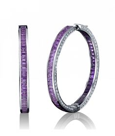 Robert Procop Exceptional Jewels. Natural pink sapphires and amethysts are faceted in matching rectangular shapes and accented by diamonds.  One of the reasons Diamond Nexus should introduce Amethyst.