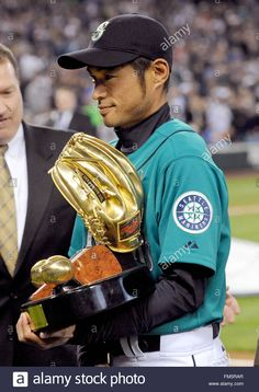 Download this stock image: Seattle Mariner Ichiro Suzuki collects his Gold Glove Award prior to his MLB baseball game against the Cleveland Indians at Safeco Field, in Seattle, USA on 08 April 2011. EPA/DAN LEVINE - FM5RAR from Alamy's library of millions of high resolution stock photos, illustrations and vectors.