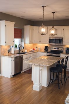 Traditional kitchen, white cabinets, Giallo Ornamental granite, Kichler pendants