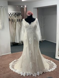 This gorgeous gown has a detachable cape, so you can change your look throughout the day. The lace trim completes the look, creating a stunning train Discount Designer Wedding Dresses, Dream Wedding Dresses, Bridal Boutique, Townhouse, Lace Trim, Cape, Train, Gowns, Fashion