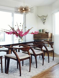 Chairs Organic Modernism table and brass urchin chandelier. Also love the dining chairs!