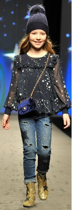 Monnalisa Girls Blue Metallic Star Shirt Distressed Jeans from the Fall Winter 2018 Fashion Show in Florence, Italy. Cute Girls Metallic Star Shirt & Embellished Star Jeans & Bleu Hat for the Fall Winter 2018 Collection. Adorable Casual Outfit for Kid, Tween, Teen Girls. Cool, Comfy & Stylish Outfit Perfect for a Party or Streetwear Look. #monnalisa #girlsclothes #girlsclothing #girlsfashion #kidsfashion #fashionkids #childrenscloth