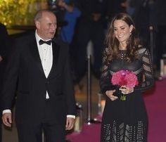 SHOP Kate Middleton wore a Temperley London Emblem Flare black knee-length dress.jpg
