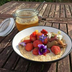 Breakfast with fruits from the forest garden - our blossom honey strawberries rhubarb and flowers (and lovely sun)