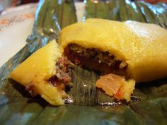 Pastelle - A Christmas delicacy consisting of beef steamed in a cornmeal pocket, wrapped in fig leaves.