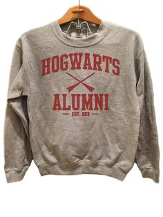 Hogwarts Alumni Simple - Sweater Available sizes for this listing are Small, Medium, Large, Extra Large, 2XL, 3XL. All sizes are standard sizes. Crew Neck sweatshirt with maroon colored ink. Image is