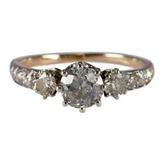 Antique platinum and gold diamond engagement ring. The style, is set with 1 old mine cut diamond, that weighs approximately carat. Estate Engagement Ring, Vintage Engagement Rings, Diamond Engagement Rings, Edwardian Jewelry, Antique Jewelry, Diamond Cuts, Pearls, Stone, Antiques
