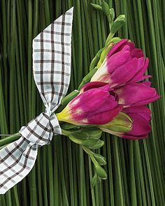 A plaid ribbon makes magenta freesia feel more masculine.