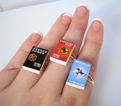 Haven't read them, but these are still cute!  Hunger Games Trilogy Book Rings! by ~beautboutique on deviantART