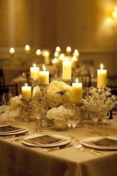 Low centerpieces with lots of candles (could mix with high centerpieces on alternating tables) - adds lots of warmth and romance to the room. Nice for a winter wedding Candle Centerpieces, Wedding Centerpieces, Pillar Candles, Floral Centerpieces, Hurricane Candle, White Centerpiece, Flameless Candles, White Candles, Centerpiece Ideas