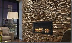 Rustic-Interior-Design-with-Stone-Wall-by-Eldorado-Stone-l-Wall-Mount-Fireplace