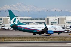 AirTran Airlines - DenverInternational. I AM going to to teach ALL the Great Mountains around the World how to clear those evil chemtrails now...