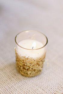 gold glitter around a simple glass votive becomes a festive decoration