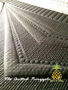 THE QUILTED PINEAPPLE: Anchor Point  All quilting is freehand  She used her straight ruler, #20 and #8 QP Curve Templates on the quilt.  Batting is Quilter's Dream Orients with a layer of Hobbs 80/20 over the top.  Threads are all So Fine by Superior Threads.