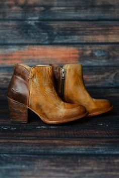 Make a bold statement in the YELL. Enjoy the charm of this dual colored bootie. The color blocked leather makes this bootie easy to mix and match with different wardrobe pieces. Elevate your fashion options with help from the YELL.