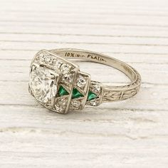 1920s Old European cut diamond & emerald engagement ring.  Love the triangle-cut emeralds!