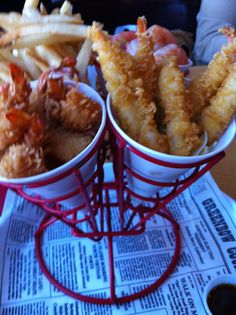 Shrimper's Heaven of Bubba Gumps restaurant. Hand breaded coconut shrimp, chilly shrimp and Japanese style tempura shrimp with fries. Comes with 3 sauces : Tangy Asian,Cajun Marmalade,Zesty Cocktail.