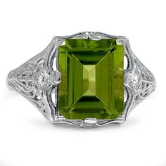 Woah. This eye-catching Edwardian ring features an emerald cut peridot surrounded by organic piercings and classic milgrain
