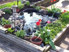 Small raised pond with a small garden surrounding it.