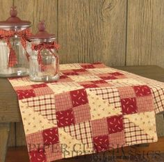 """Red and cream 4-patches plus half-square triangles.  Simple and appealing.  At http://www.piperclassics.com/products/Apple_Jack_Table_Runner_36-4793-79.html.  Apple Jack Table Runner - 36"""""""