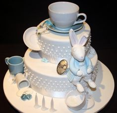 un-birthday or mad-hatter tea party cake.  Love the white rabbit!