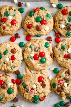 These thick and chewy Christmas Peanut Butter Cowboy Cookies are the best bakery-style oatmeal cookies ever! Super loaded with peanut butter, oats, salted peanuts, sweetened coconut, white and milk chocolate chips and festive colored m&ms! Easy to make and addictive! #cowboycookies #cookies #m&mcookies #christmascookies #peanutbutteroatmeal #peanutbuttercookies #oatmealcookies #bestcookies #rangercookies #holidaycookies #dessert