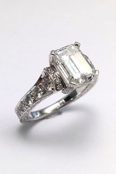 Large Emerald Cut Diamond Cathedral Graduated pave Engagement Ring